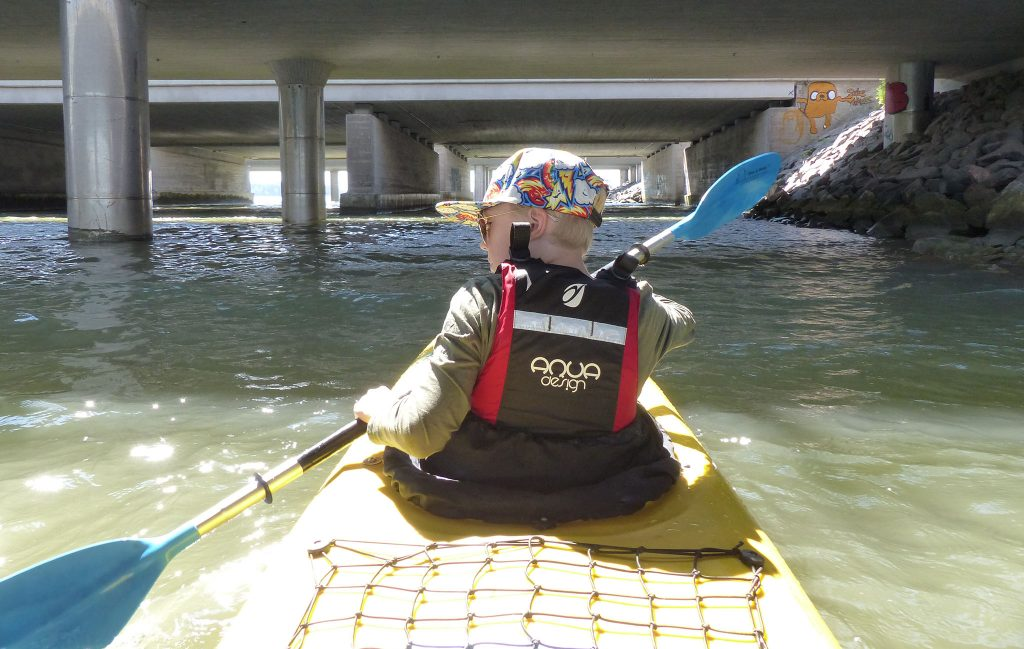 kayaker under the bridge
