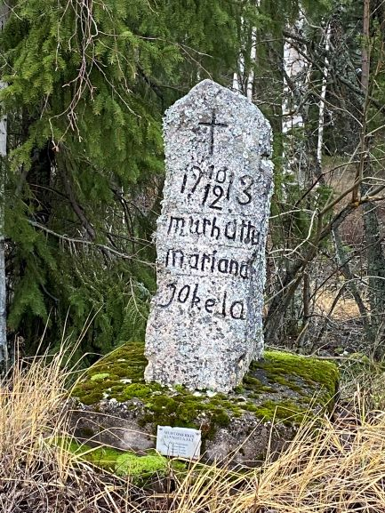 Tombstone along the road
