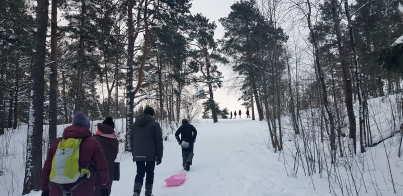 Sledding down Taivaskallio hill