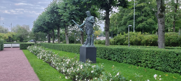 Kullervo addressing his sword. Ill-fated character of Kalevala, the Finnish national epic. Statue at Helsinki Winter and Rose Garden.
